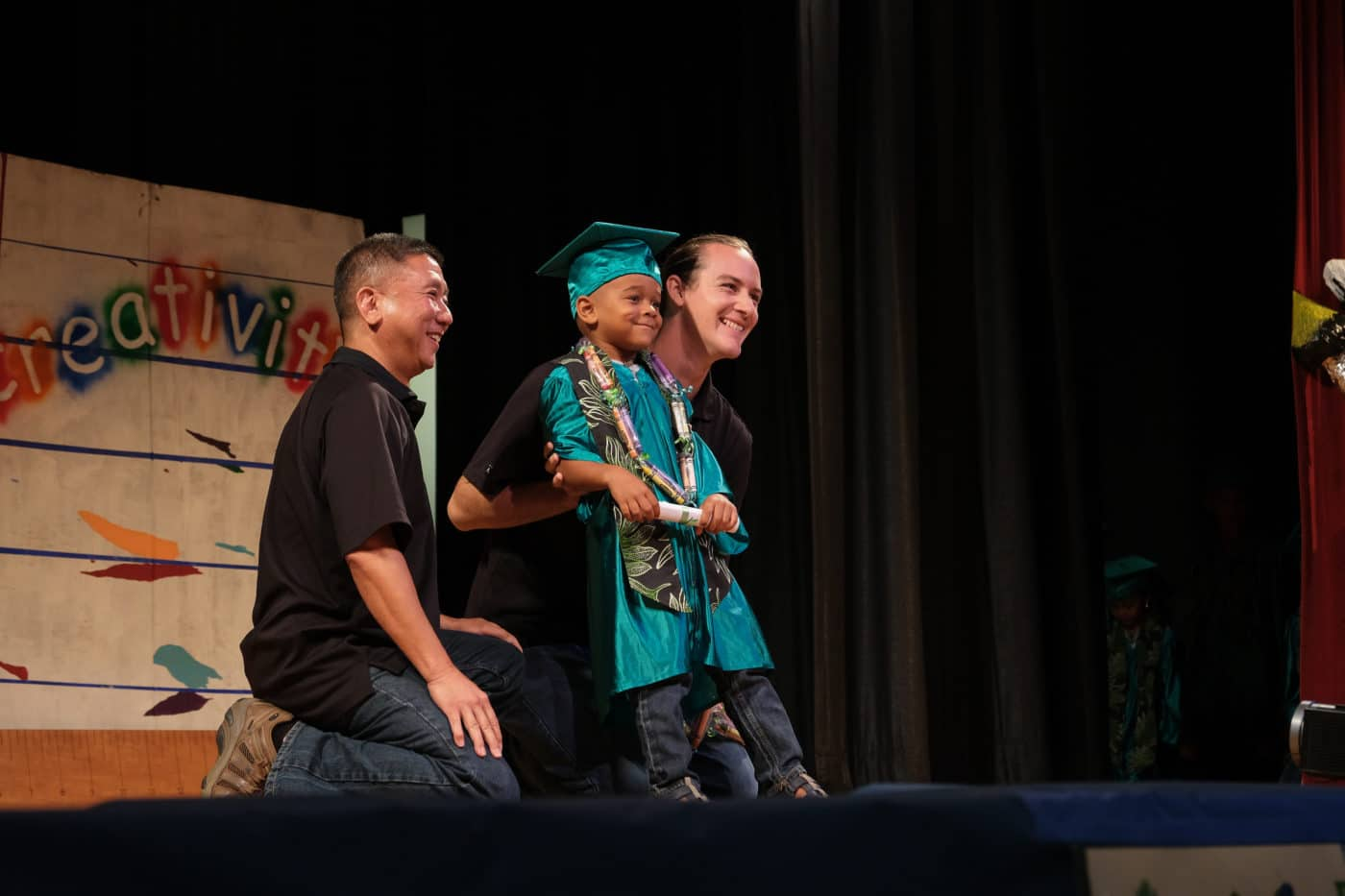 Our of the 57 graduating keiki poses with his teacher